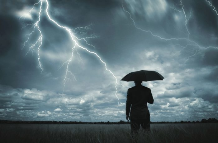 Man in a storm, management consulting in Nashville, TN, for executive coaching and crisis management, call Agility Nashville today.