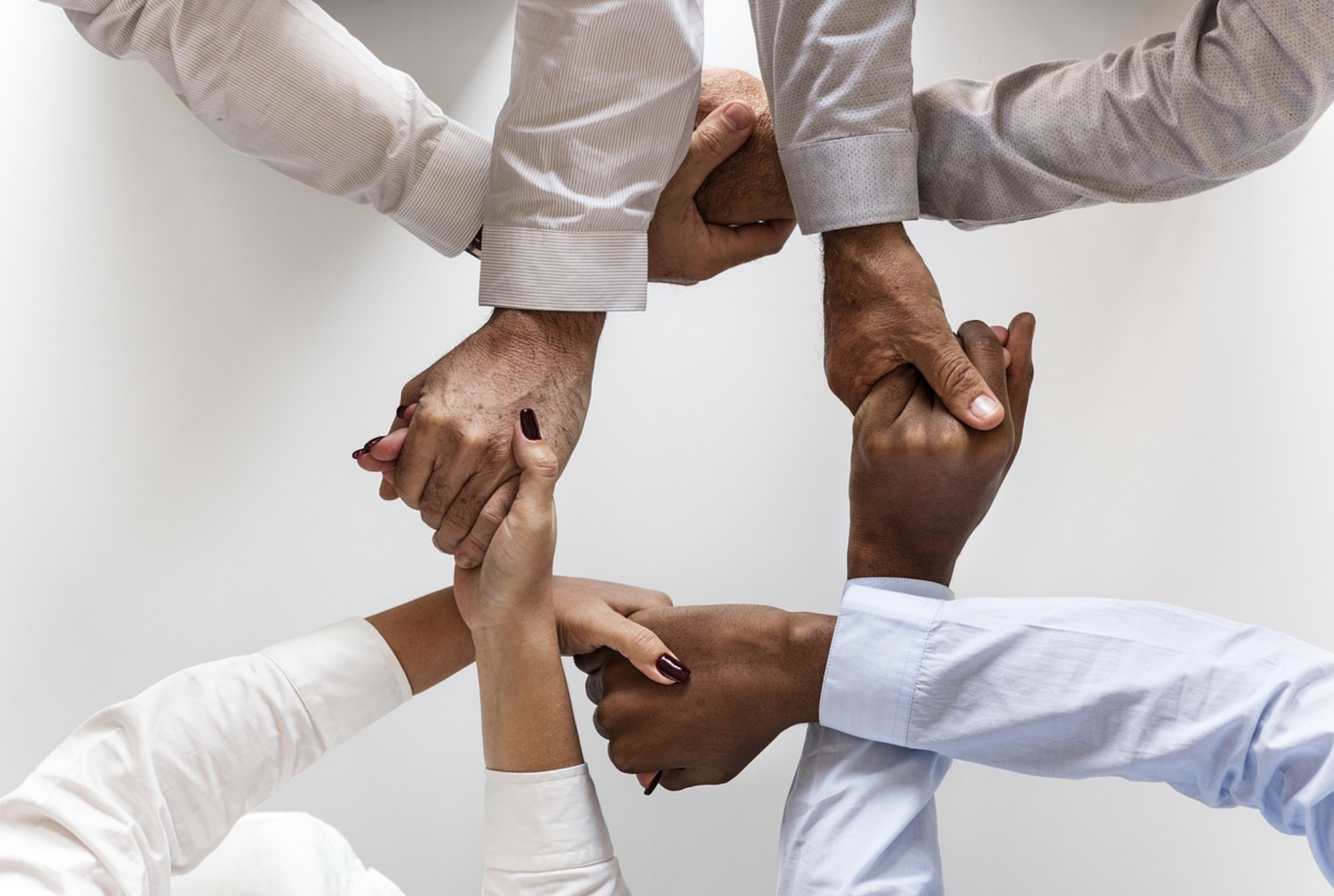 Hands intertwined, Agility Leadership management consulting in Nashville, TN, leadership training, executive coaching and executive development.
